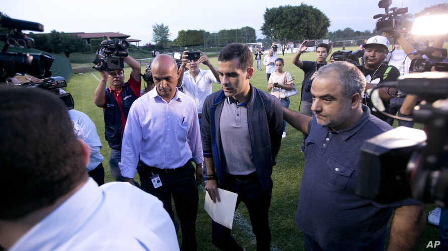 Mexican soccer star Rafael Marquez Alvarez, center, arrives to give a press conference to deny accusations of ties to drug trafficking, at Atlas Football Club in Guadalajara, Mexico, Aug. 9, 2017.