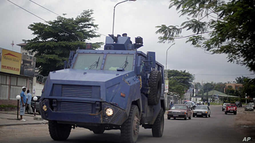 Congolese riot  police  in an armored vehicle drive the streets of  Kinshasa, Democratic Republic of Congo,  December 7,  2011.