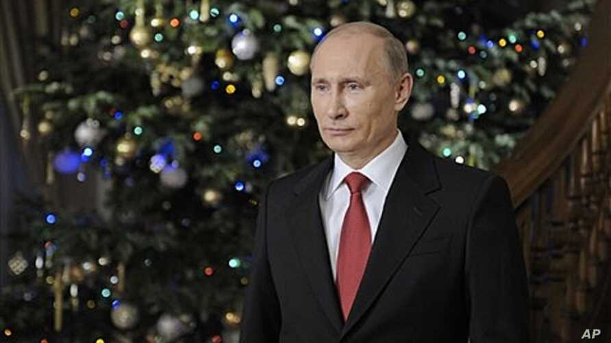Russian Prime Minister Vladimir Putin wishes Russians a happy New Year, Dec. 31, 2011.