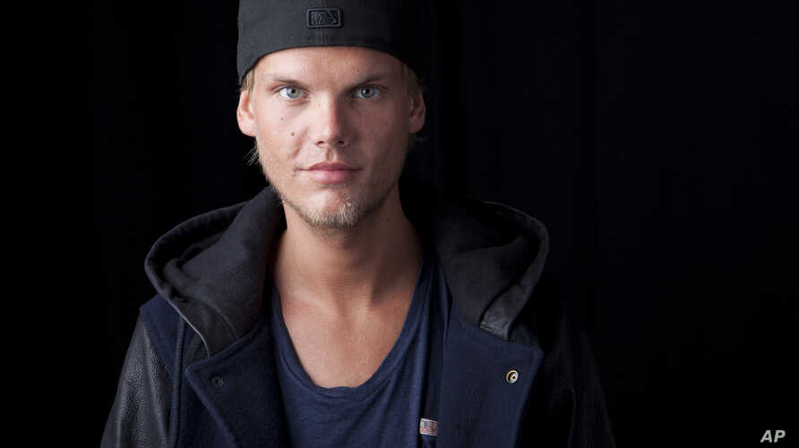 Swedish DJ, remixer and record producer Avicii poses for a portrait, Aug. 30, 2013 in New York.