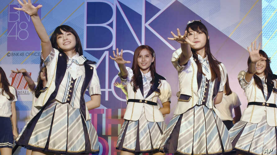 In this June 2, 2017, file photo, Thai pop band BNK 48 performs for the first time in a large commercial facility in  Bangkok, Thailand.