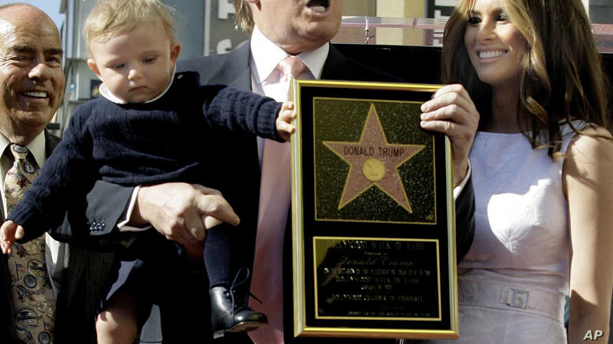 "Donald Trump, the billionaire developer, and producer of NBC's ""The Apprentice,"" with his wife, Melania Knauss, and their son, Barron, pose for a photo after he was honored with a star on the Hollywood Walk of Fame in Los Angeles, Tuesday, Jan. 16, 2"