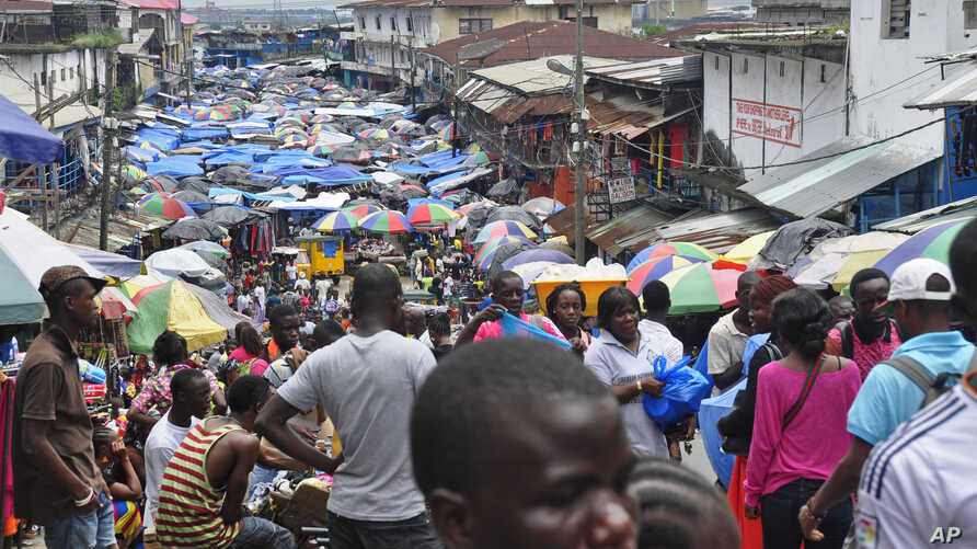 The Waterside local market with people doing business as usual despite fears of the Ebola virus in city center of Monrovia, Liberia, Tuesday, Aug. 19, 2014. The World Health Organization says the outbreak has killed more than 1,200 people, while auth