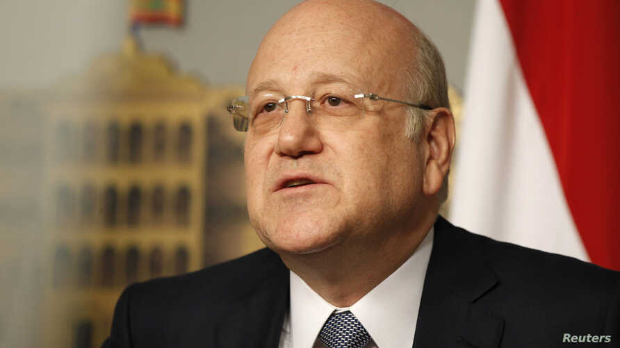 Lebanon's Prime Minister Najib Mikati speaks during a news conference at the Grand Serail, the government headquarters, in Beirut, March 22, 2013.