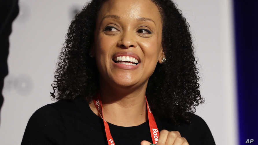 "FILE - Author Jesmyn Ward speaks at Book Expo America in New York, June 1, 2017. Ward's ""Sing, Unburied, Sing,"" winner of the National Book Award for fiction, is a nominee for the National Book Critics Circle prize."