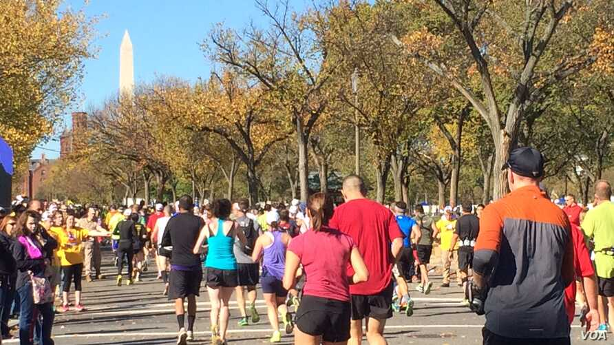 Runners head west on Independence Avenue in Washington Sunday as they near the 19-mile mark of the Marine Corps Marathon. The Washington Monument can be seen in the distance.