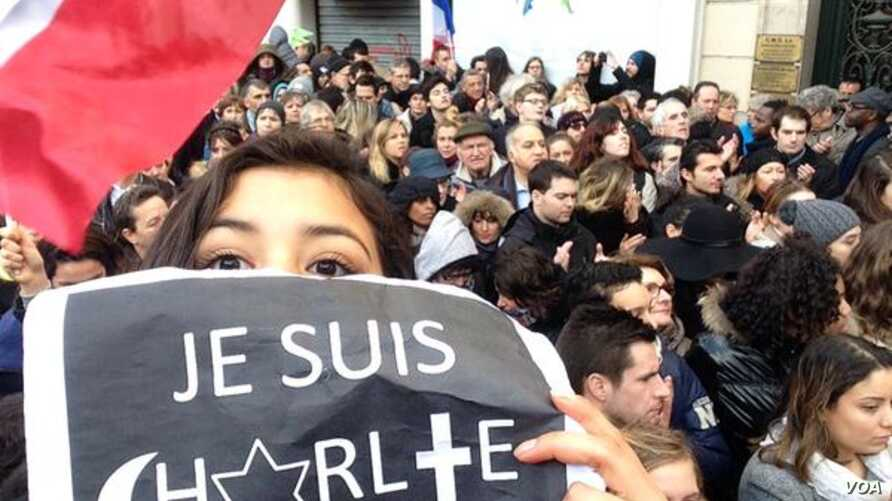 College student Lila Hassan shows her solidarity with France in a selfie from the historic march in Paris' Place de la Republique, posted on her Twitter account Jan. 11, 2015. (Courtesy Photo / Lila Hassan)