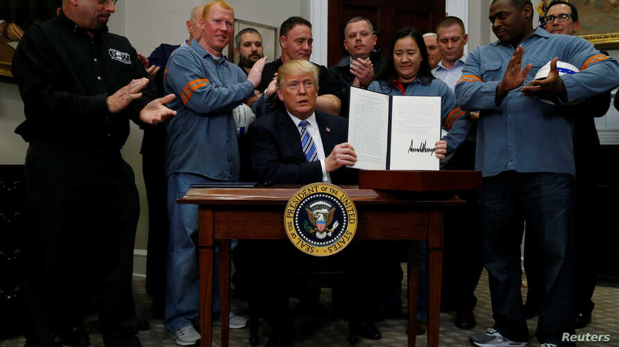 U.S. President Donald Trump is after signing a proclamation to establish tariffs on imports of steel and aluminum at the White House in Washington, March 8, 2018.