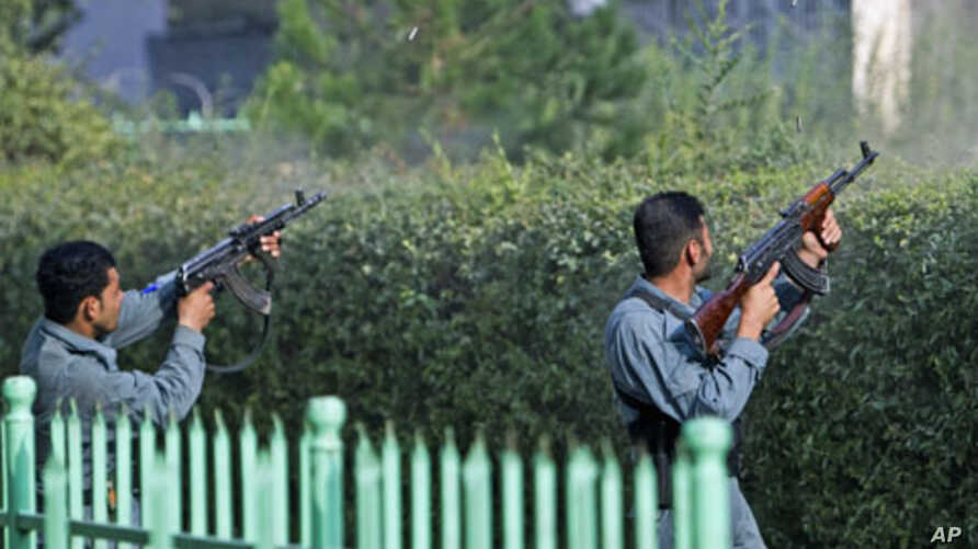 Afghan policemen fire toward a building that the Taliban insurgents took over during an attack near the U.S. embassy in Kabul, Afghanistan, September 13, 2011.