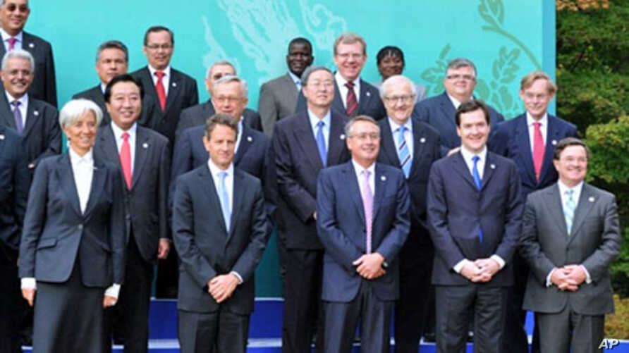 (L-R front row) France's Economy Minister Christine Lagarde, US Treasury Secretary Timothy Geithner, Australia's treasurer Wayne Swan, UK Chancellor of the Exchequer George Osborne, Canada Finance minister Jim Flaherty pose for a group photo at the G