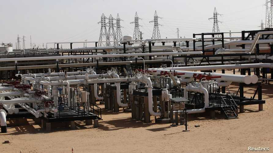 FILE - Pipes are pictured at the El Sharara oilfield, Dec. 3, 2014.