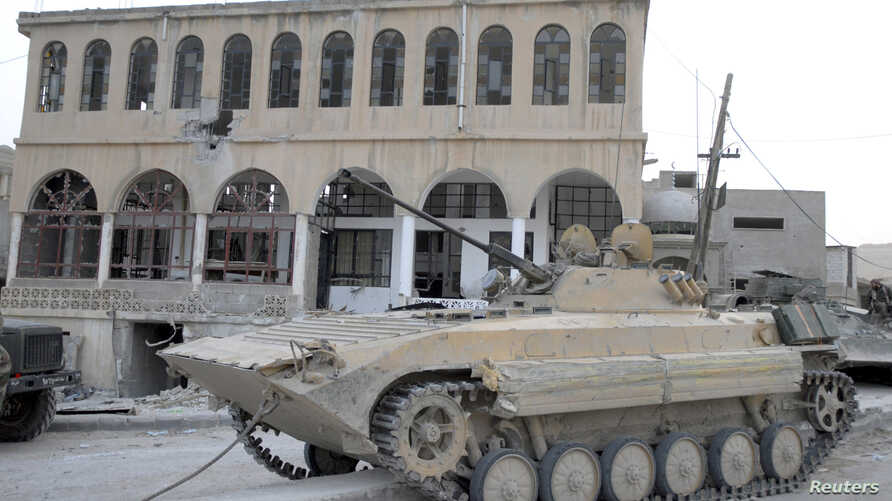 A tank belonging to the forces of Syria's President Bashar al-Assad is seen at Al-Sahl town, about 2km (a mile) to Yabroud's north, after the soldiers took control of it from the rebel fighters, March 3, 2014.