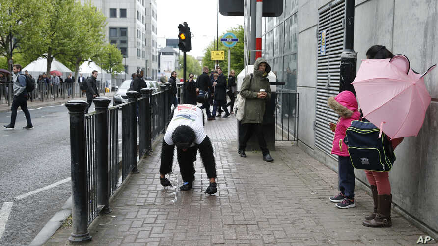 "Tom Harrison, also known as Mr. Gorilla, makes his way crawling along part of the London Marathon course in a bid to support the charity ""Gorilla Organization,"" in London, April 27, 2017."