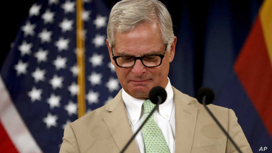 Rick Davis, spokesperson for Sen. John McCain's family, reacts as he speaks to the media during a news conference, Aug. 27, 2018, in Phoenix, Arizona.