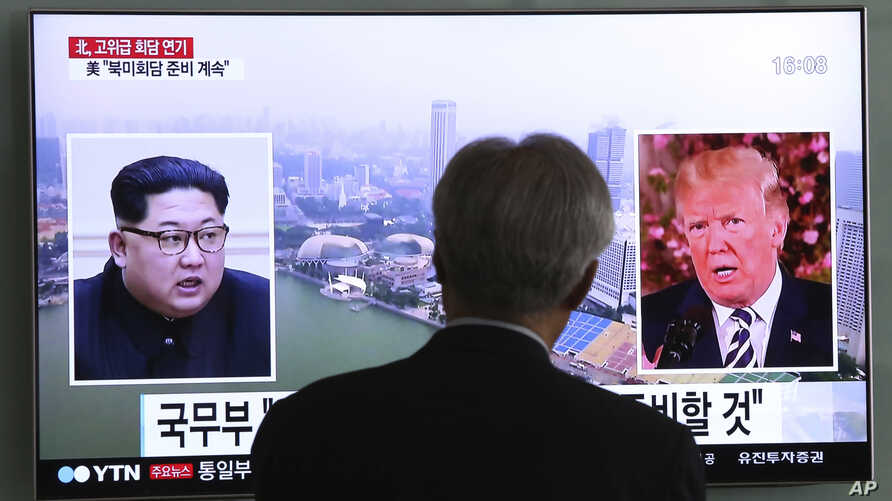 A man watches a TV screen showing file footage of President Trump, right, and North Korean leader Kim Jong Un at the Seoul Railway Station in Seoul, South Korea, May 16, 2018.