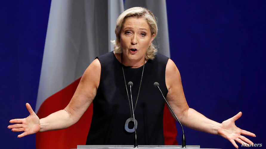"""French far-right National Rally (Rassemblement National) party leader Marine Le Pen delivers her comeback speech in Frejus, France, Sept. 16, 2018. The backdrop reads """"Nations will save Europe""""."""