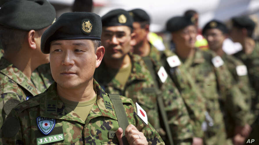 FILE - Members of the Japan Self-Defense Forces arrive at the airport in Juba, South Sudan, Nov. 21, 2016. Japanese peacekeepers, with a broader mandate to use force, landed in South Sudan in the first such deployment of the country's troops overseas