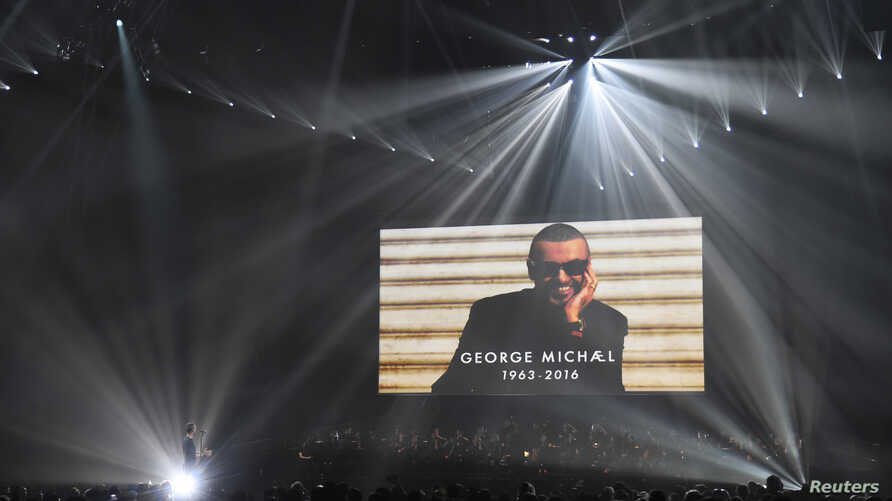 Chris Martin of Coldplay performs a tribute to George Michael at the Brit Awards at the O2 Arena in London, Feb. 22, 2017.