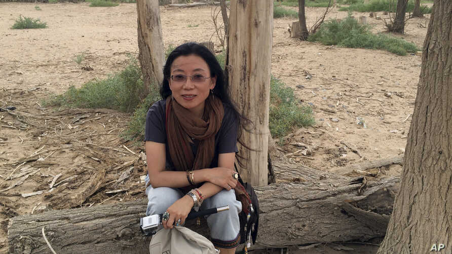 Well-known Tibetan writer Tsering Woeser poses for a photo in Inner Mongolia in northern China, June 23, 2014.