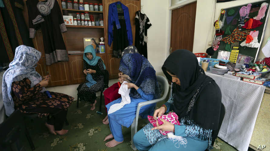 Victims of violence sew at a shelter operated by the Humanitarian Assistance for the Women and Children of Afghanistan, an NGO, in Kabul, Afghanistan, April 5, 2017.