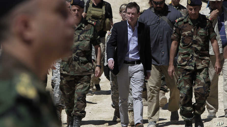 U.S. Ambassador to Lebanon David Hale (C) arrives in Taibeh village near the city of Baalbek, eastern Lebanon, Wednesday, June 10, 2015, where he was to attend a Lebanese army live-fire demonstration of advanced U.S. missiles.