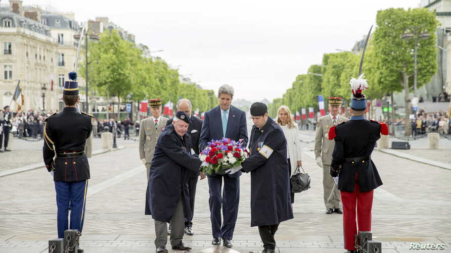 U.S. Secretary of State John Kerry (C) lays a wreath during a ceremony marking France's 70th anniversary of the allied victory over Nazi Germany, at the Tomb of the Unknown Soldier in Paris, France, May 8, 2015.