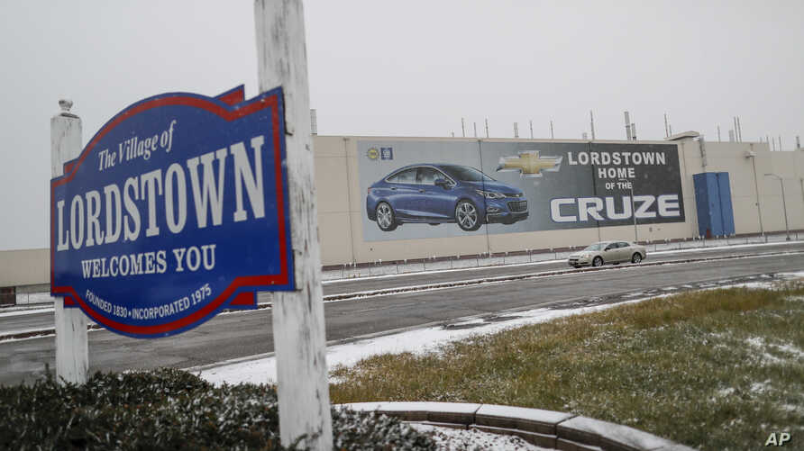 A banner depicting the Chevrolet Cruze vehicle is displayed at the General Motors' Lordstown plant, Nov. 27, 2018, in Lordstown, Ohio. Even though the economy is growing, GM is cutting thousands of jobs in a major restructuring aimed at generating ca