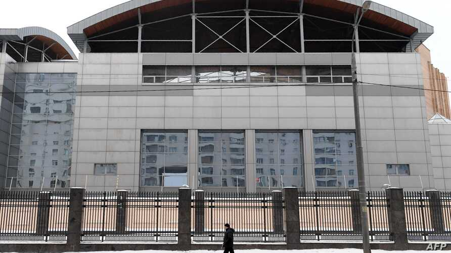 FILE - A man walks past the building of the headquarters of the Russian General Staff's Main Intelligence Department (GRU) in Moscow, Dec. 30, 2016.