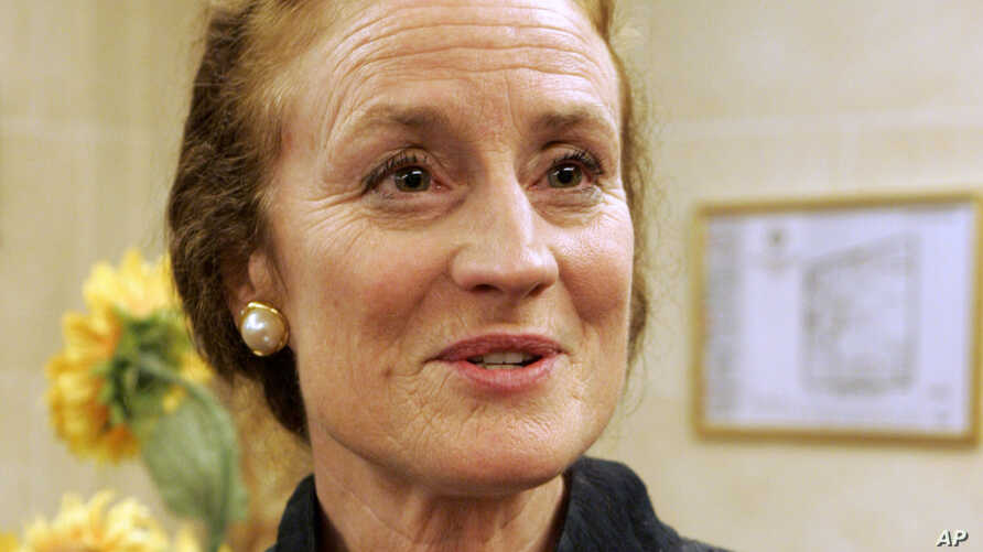 FILE - Henrietta Holsman Fore, then-US administrator of the Agency for International Development (USAID), answers a reporter during an interview in Paris, June 11, 2008.