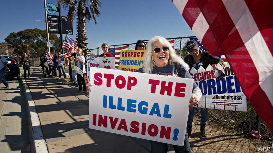 "Demonstrators chant during an ""America First"" rally at the San Ysidro Port of Entry along the United States-Mexico border in San Ysidro, California, December 15, 2018."