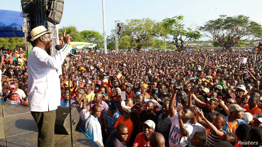 Kenyan opposition leader Raila Odinga addresses supporters during a rally in Mombasa, Kenya, Oct. 15, 2017.