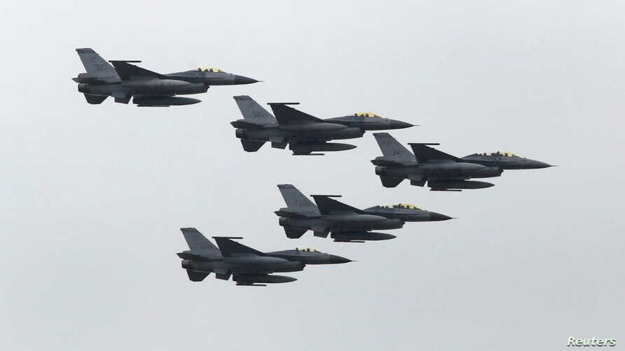 FILE - Taiwan Air Force's F-16 fighter jets fly during the annual Han Kuang military exercise at an army base in Hsinchu, northern Taiwan, July 4, 2015.