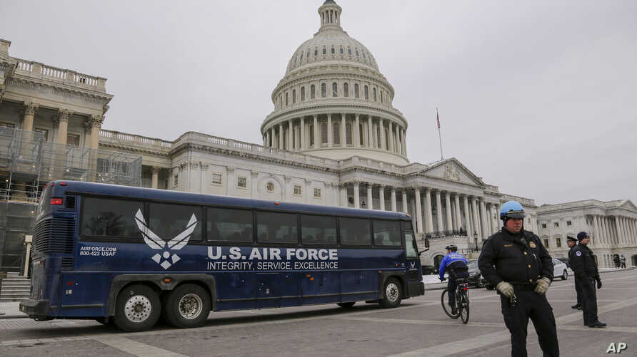 An Air Force bus waits on the plaza of the Capitol after President Donald Trump used his executive power to deny military aircraft to House Speaker Nancy Pelosi just before she was depart to visit troops abroad, on Capitol Hill in Washington, Jan. 17