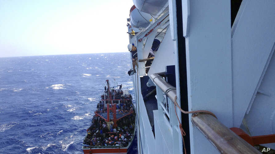 Apparent refugees are seen on a small boat after being rescued off the Cyprus's main Limassol port, Cyprus, Sept. 25, 2014.