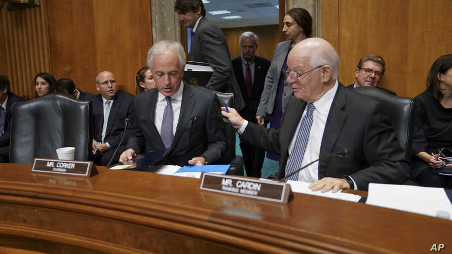 Chairman Sen. Bob Corker, R-Tenn., left, talks with Ranking member Sen. Ben Cardin, D-Md., before the start of a Senate Foreign Relations Committee hearing on North Korea and President Donald Trump's nuclear authority, on Capitol Hill in Washington,