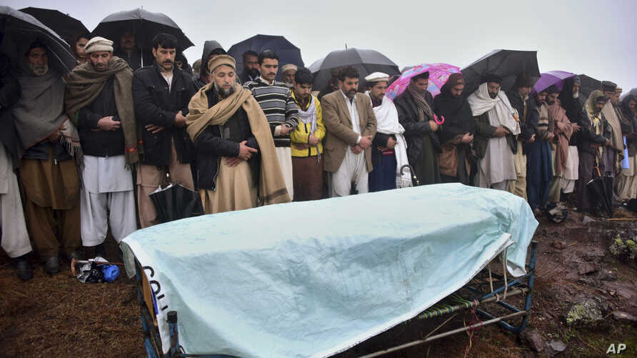 Villagers carry offer prayers at the funeral of a boy killed by Indian shelling, at a village in Hatian Bala, 40 kilometers from Muzafarabad, capital of Pakistani-controlled Kashmir, March 2, 2019.