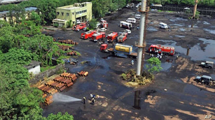 Indian firemen and vehicles are gathered in a port trust area after a leak of chlorine gas in Mumbai, 14 Jul 2010