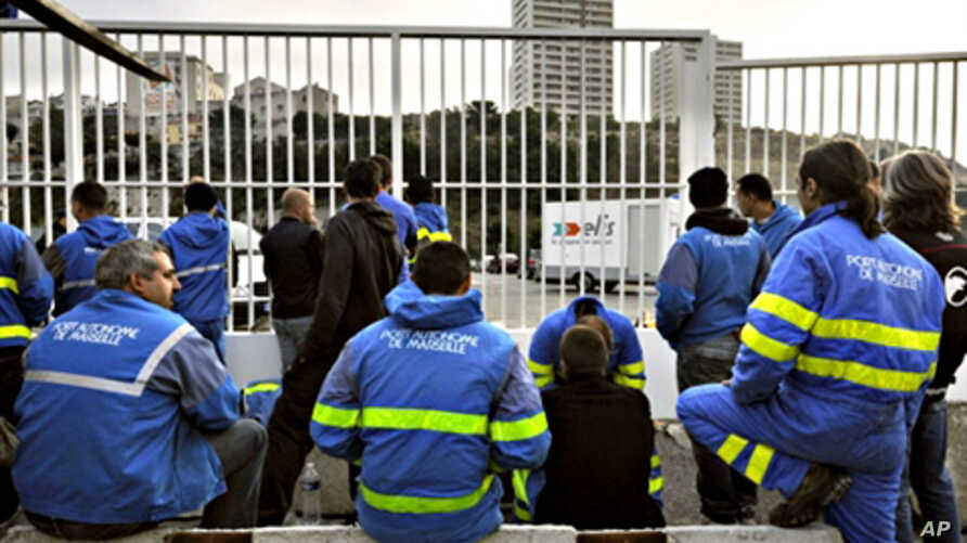 Dockers from Marseille block the way to the harbour during a strike to protest against the implementation of harbour reforms and ask for the recognition of the hardship at work, an important factor for pensions, 01 Oct. 2010