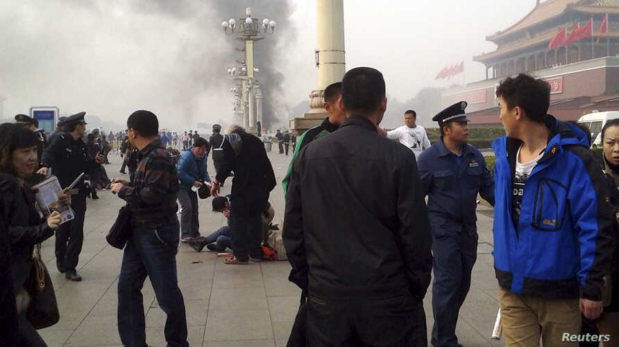 Smoke rises near the main entrance of the Forbidden City at Tiananmen Square in Beijing Oct. 28, 2013,after a car ploughed into pedestrians and caught fire.