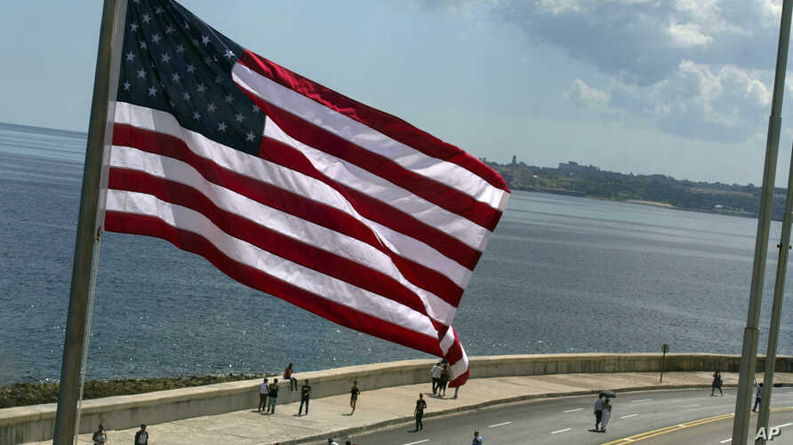 The U.S. flag waves outside the newly opened U.S. Embassy, overlooking Havana's seaside boulevard, the Malecon in Cuba, Aug. 14, 2015.