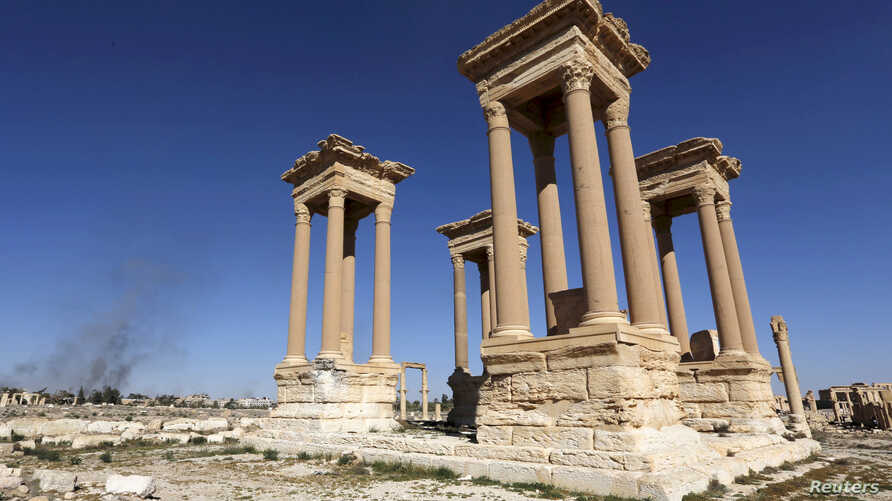 FILE - A view shows the Tetrapylon, one of the most famous monuments in the ancient city of Palmyra, Syria, April 1, 2016.