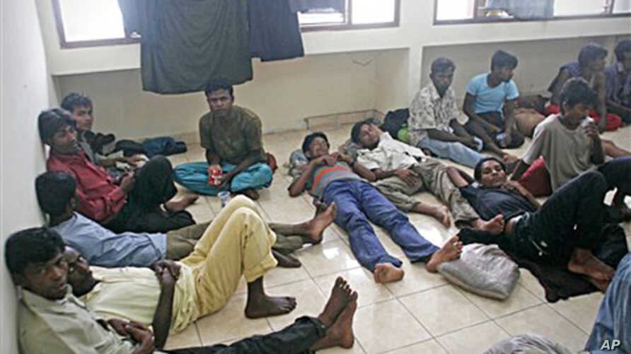 Ethnic Rohingya boat people rest after being rescued at a port in Aceh Besar, Indonesia, February 16, 2011