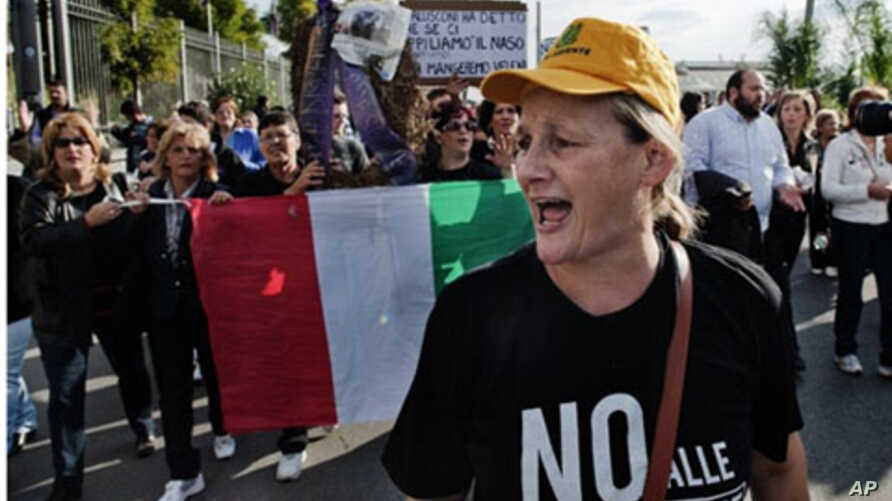 Demonstrators protest against the opening of a new dump in Terzigno on the slopes of Mount Vesuvius, near Naples, 24 October 2010