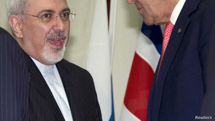 U.S. Secretary of State John Kerry (R) shakes hands with Iranian Foreign Minister Mohammad Javad Zarif at the United Nations Palais in Geneva, Nov. 24, 2013.