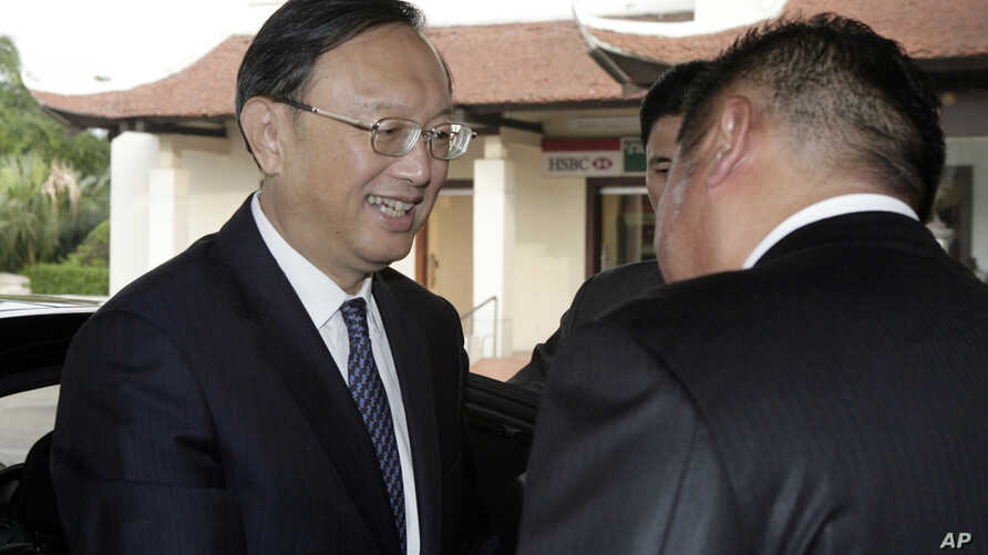 In the first high-level meeting between China and Vietnam since China's deployment of a giant oil rig off the Vietnamese coast last month increased tensions between the two, Chinese State Councilor Yang Jiechi, left, is greeted by a hotel executive a