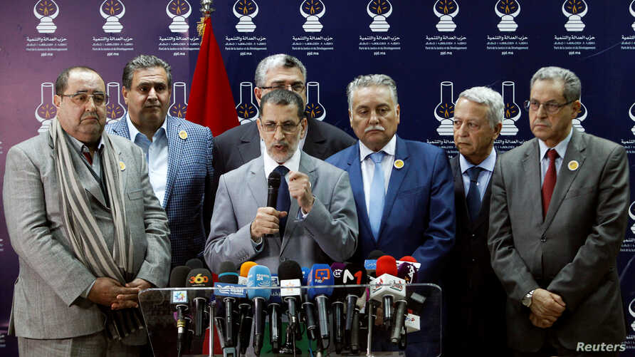 Morocco's new Prime Minister Saad Eddine El Othmani, center, gives a news conference next to Driss Lachgar, left, of the Socialist Union of Popular Forces party (USFP), Aziz Akhannouch, second left, of the National Rally of Independents (RNI), Mohame