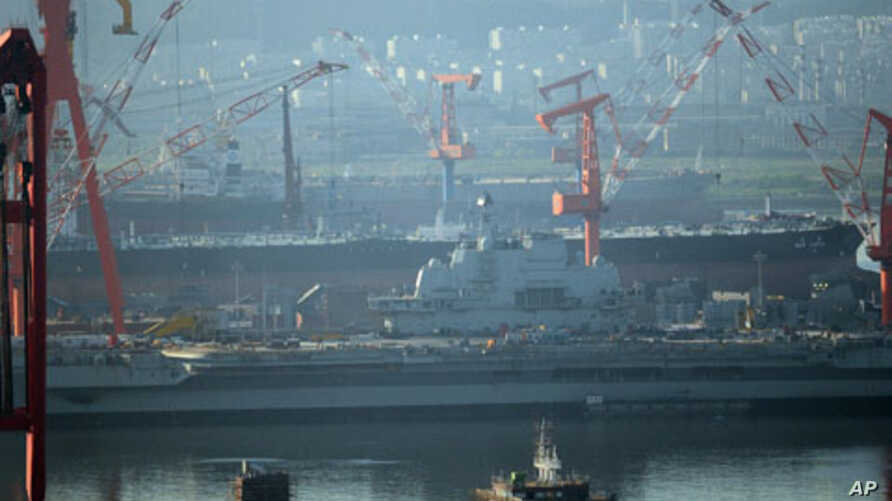 The 300-meter former Soviet carrier, originally called the Varyag, as she is overhauled in the northeast port of Dalian, northwest China's Liaoning province on July 4, 2011.
