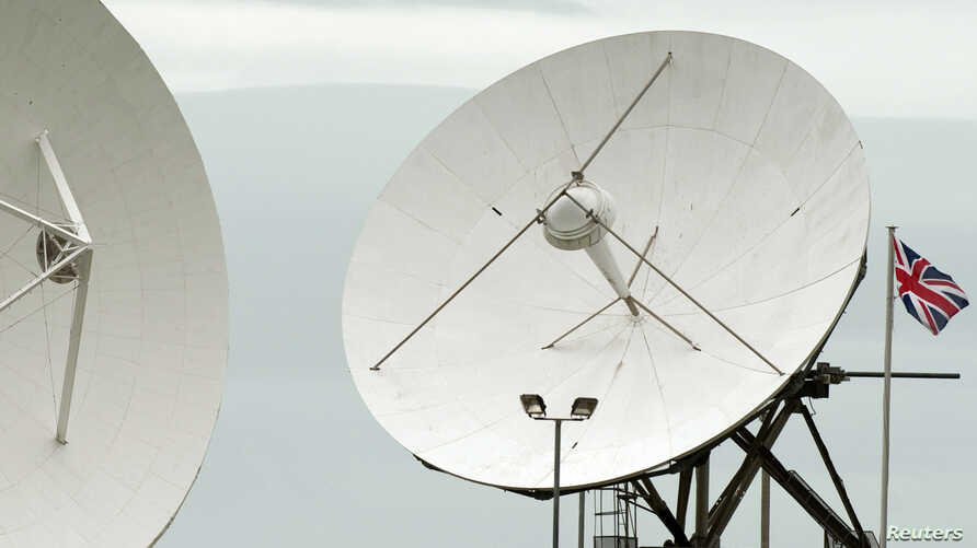 "FILE - Satellite dishes are seen at GCHQ's outpost at Bude, close to where trans-Atlantic fiber-optic cables come ashore in Cornwall, southwest England June 23, 2013. On Monday, with a simple ""Hello, world,"" the secretive agency joined the Twittersph"