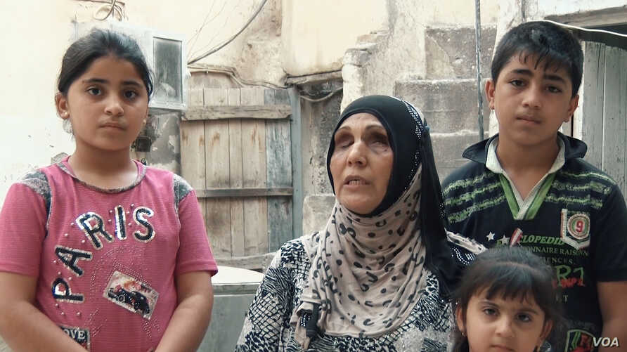 Ibstisam Muhammad, 51, works full time making bread to support her family — she has four children, ages 4 to 18 — even after she was blinded by an Islamic State bombing.