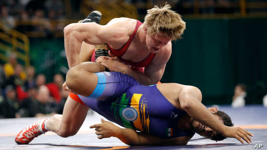 United State's Hayden Zillmer, top, controls India's Deepak Punia during their 92 kg match in the Freestyle Wrestling World Cup, April 7, 2018, in Iowa City, Iowa.